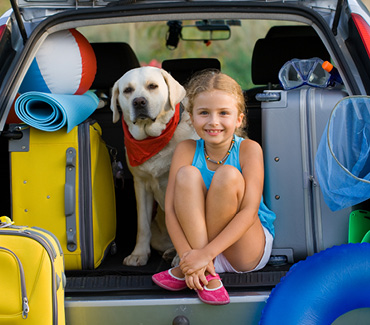 Girl and dog preparing for travel